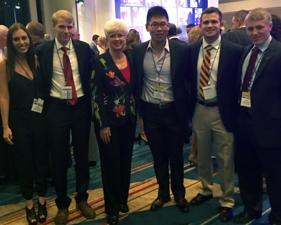 InNOLEvation® Project students Katie Wallshein, C.J. Wagner, Zhiqiang Shu, Chris Holzworth and Chris Mergenthaler with Jan Moran at the 2015 Jim Moran Classic benefiting the Youth Automotive Training Center.