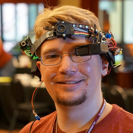Ryan Whitney, displaying his head-mounted, wearable computing device